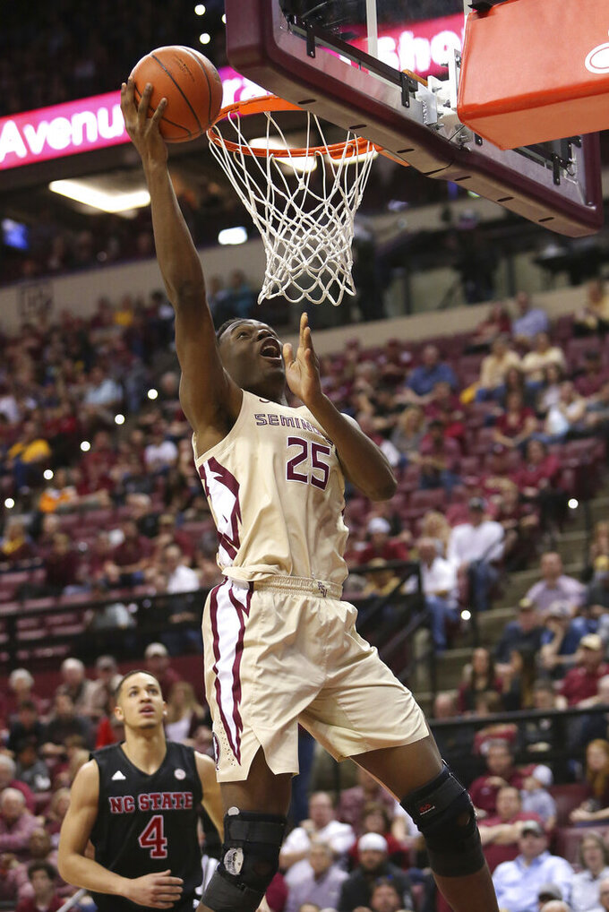 Florida State's Mfiondu Kabengele breaks away to score against North Carolina State in the first half of an NCAA college basketball game Saturday, March 2, 2019, in Tallahassee, Fla. (AP Photo/Steve Cannon)