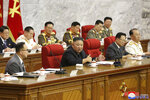 In this photo provided by the North Korean government, North Korean leader Kim Jong Un, center, speaks during a Workers' Party meeting in Pyongyang, North Korea, Thursday, June 17, 2021. Kim ordered his government to be fully prepared for confrontation with the Biden administration, state media reported Friday, June 18, days after the United States and other major powers urged the North to abandon its nuclear program and return to talks. Independent journalists were not given access to cover the event depicted in this image distributed by the North Korean government. The content of this image is as provided and cannot be independently verified. (Korean Central News Agency/Korea News Service via AP)