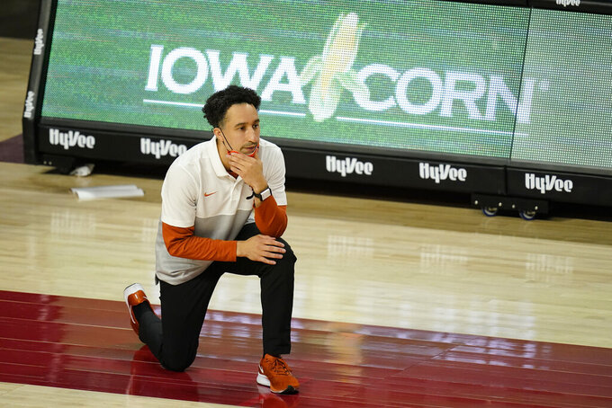 Texas head coach Shaka Smart watches from the bench during the first half of an NCAA college basketball game against Iowa State, Tuesday, March 2, 2021, in Ames, Iowa. (AP Photo/Charlie Neibergall)