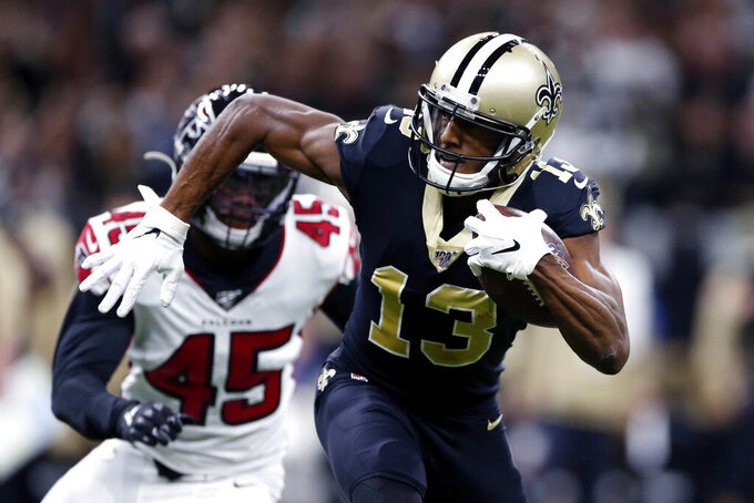 New Orleans Saints wide receiver Michael Thomas (13) carries on a pass reception in front of Atlanta Falcons linebacker Deion Jones (45) in the first half of an NFL football game in New Orleans, Sunday, Nov. 10, 2019. (AP Photo/Rusty Costanza)