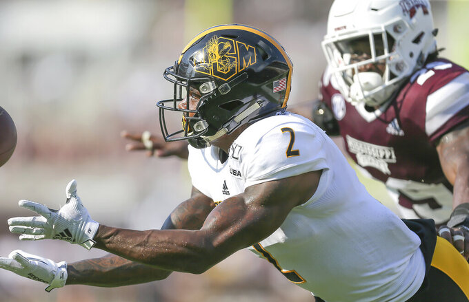 Southern Mississippi wide receiver Jaylond Adams (2) catches a pass for a touchdown ahead of the defense from Mississippi State safety C.J. Morgan (29) during the second half of an NCAA college football game Saturday, Sept. 7, 2019, in Starkville, Miss. (Keith Warren/The Clarion-Ledger via AP)