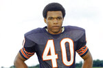 "FILE - This is a 1970 file photo showing Chicago Bears football player Gale Sayers. Hall of Famer Gale Sayers, who made his mark as one of the NFL's best all-purpose running backs and was later celebrated for his enduring friendship with a Chicago Bears teammate with cancer, has died. He was 77. Nicknamed ""The Kansas Comet"" and considered among the best open-field runners the game has ever seen, Sayers died Wednesday, Sept. 23, 2020, according to the Pro Football Hall of Fame. (AP Photo/FIle)"