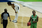 North Texas's Javion Hamlet celebrates after North Texas defeated Purdue, 78-69, in overtime of a first-round game in the NCAA men's college basketball tournament at Lucas Oil Stadium, Friday, March 19, 2021, in Indianapolis. (AP Photo/Darron Cummings)
