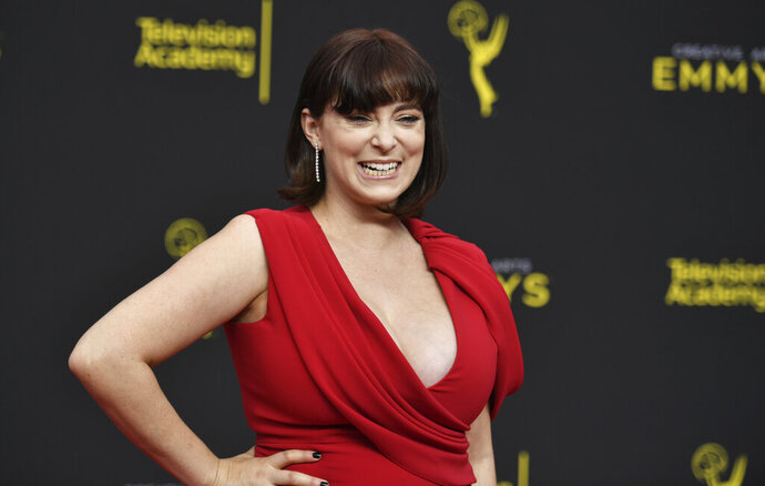 FILE - In this Sept. 15, 2019, file photo, Rachel Bloom arrives at night two of the Creative Arts Emmy Awards at the Microsoft Theater in Los Angeles. Pop TV has ordered a comedy pilot focused on the most irresponsible and lazy person getting impregnated by immaculate conception.