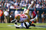San Francisco 49ers wide receiver Deebo Samuel (19) is tackled by Philadelphia Eagles safety Marcus Epps (22) during the first half of an NFL football game Sunday, Sept. 19, 2021, in Philadelphia. (AP Photo/Matt Rourke)