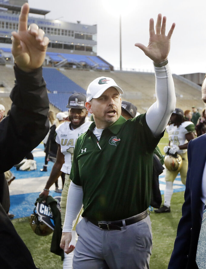 UAB head coach Bill Clark waves to fans as he leaves the field after UAB defeated Middle Tennessee in the NCAA Conference USA championship college football game Saturday, Dec. 1, 2018, in Murfreesboro, Tenn. UAB won 27-25. (AP Photo/Mark Humphrey)