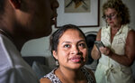 In this Wednesday, Aug. 21, 2019 photo, Guatemalan immigrant Rosayra Pablo Cruz, center, and her son Yordy, 17, have a conversation near her host Vivien Tartter, background, a college professor who opened her home to Cruz and her family for a year, in New York. The host-an-immigrant movement irks many who favor limiting immigration. The president of the Americans for Legal Immigration PAC, said hosting immigrants is wrong because U.S. laws state that