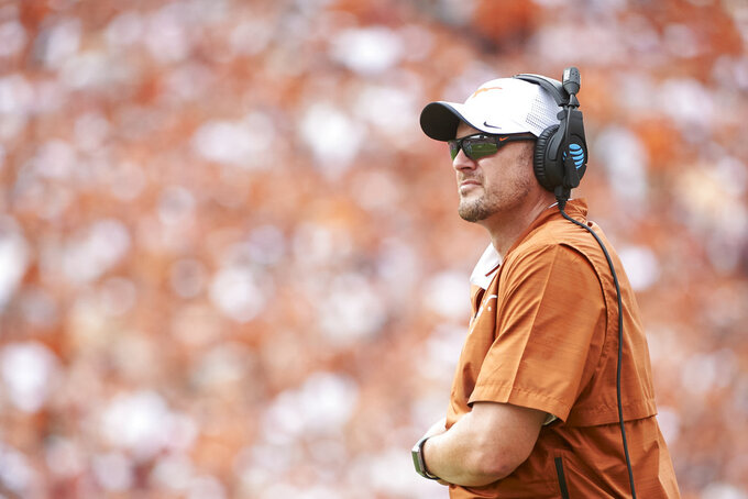 Texas head coach Tom Herman looks on during the second half of an NCAA college football game against Oklahoma at the Cotton Bowl, Saturday, Oct. 6, 2018, in Dallas. (AP Photo/Cooper Neill)