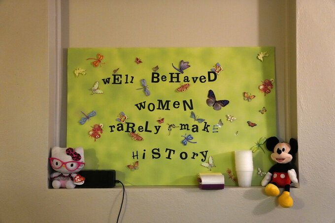 A sign adorns the wall inside a procedure room where doctors perform abortions, ahead of the arrival of patients at the start of the workday, Saturday, Oct. 9, 2021, at Hope Medical Group for Women in Shreveport, La. The nation's most restrictive abortion law is driving many women from Texas to seek services in neighboring states. The abortion clinic in Shreveport is among the clinics being inundated. (AP Photo/Rebecca Blackwell)