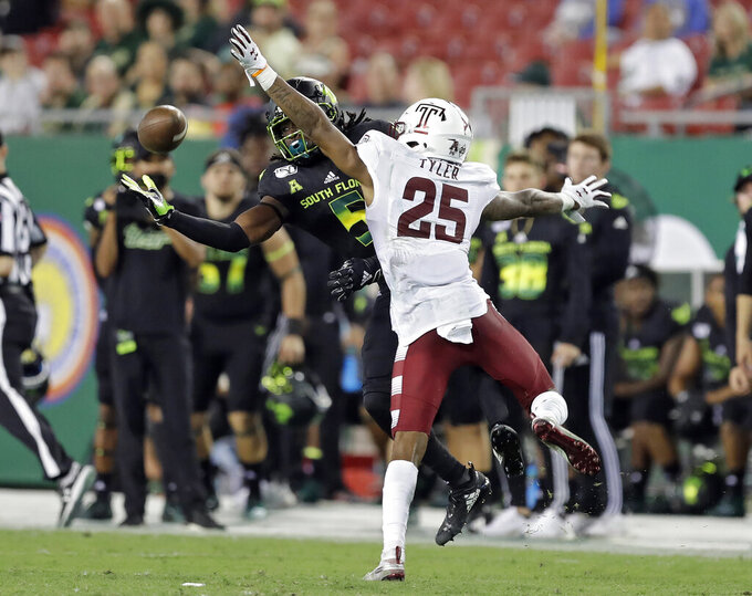South Florida wide receiver Randall St. Felix (5) gets hit by Temple safety Amir Tyler (25) as he reaches for a pass during the second half of an NCAA college football game Thursday, Nov. 7, 2019, in Tampa, Fla. Tyler was called for pass interference on the play. (AP Photo/Chris O'Meara)