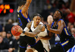 Cincinnati guard Justin Jenifer (3) is double-teamed by Tulsa guards Elijah Joiner (3) and Sterling Taplin (4) during the first half of an NCAA college basketball game Thursday, Jan. 24, 2019, in Cincinnati. (Sam Greene/The Cincinnati Enquirer via AP)