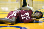 Washington State guard Noah Williams (24) reacts after falling to the floor while shooting against Stanford during the first half of an NCAA college basketball game in Santa Cruz, Calif., Saturday, Jan. 9, 2021. (AP Photo/Jeff Chiu)