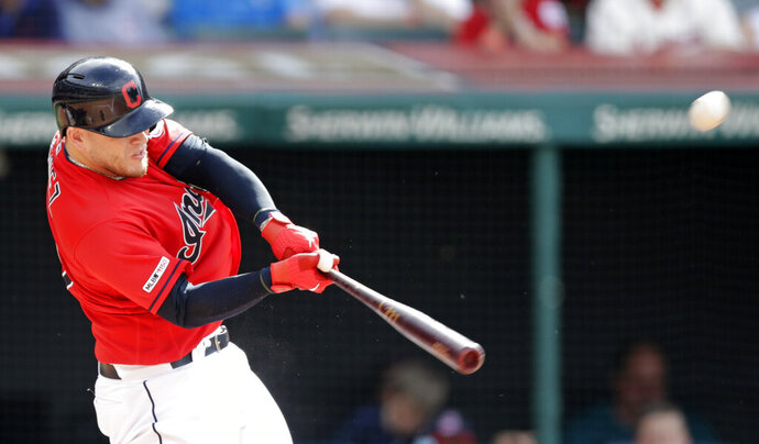 Cleveland Indians' Roberto Perez hits a one-run double in the fourth inning in a baseball game against the New York Yankees, Saturday, June 8, 2019, in Cleveland. Jordan Luplow scored on the play. (AP Photo/Tony Dejak)