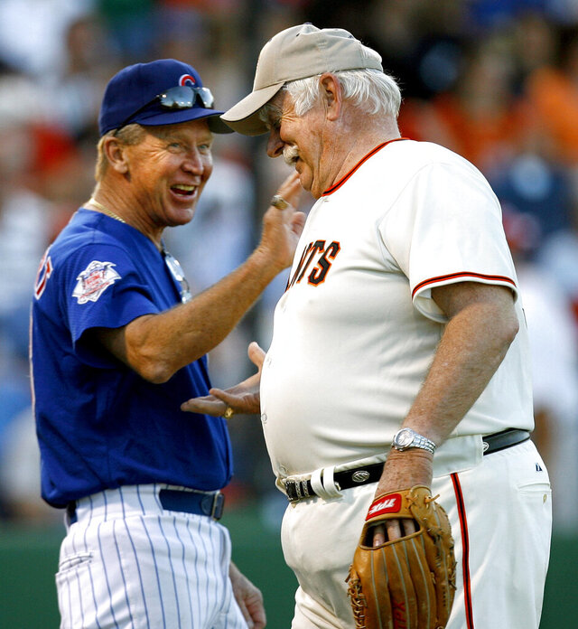 FILE - In this March 25, 2007 file photo, former Chicago Cubs great Glenn Beckert, left, exchanges greetings with Hall of Fame pitcher Gaylord Perry as the pair participate in the Legends of Baseball game at Bright House Networks Field in Clearwater, Fla. Beckert, a four-time All-Star second baseman for the Chicago Cubs in the 1960s and '70s, died in Florida Sunday, April 12, 2020, of natural causes.  He was 79. (Joseph Garnett/Tampa Bay Times via AP, File)