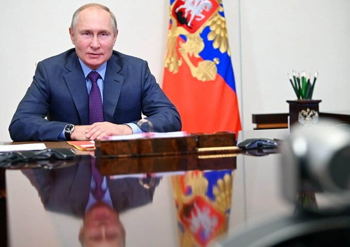 Russian President Vladimir Putin chairs a Security Council meeting via video conference at the Novo-Ogaryovo residence outside Moscow, Russia, Friday, July 23, 2021. (Alexei Nikolsky, Sputnik, Kremlin Pool Photo via AP)