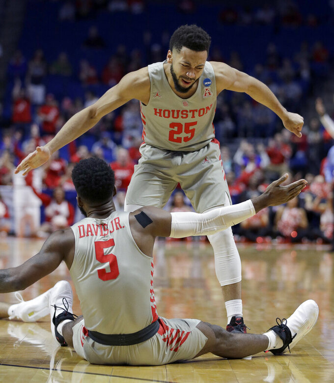 Houston's Galen Robinson Jr. (25) and Corey Davis Jr. (5) celebrate after a basket during the first half of a first round men's college basketball game against Georgia State in the NCAA Tournament Friday, March 22, 2019, in Tulsa, Okla. (AP Photo/Charlie Riedel)