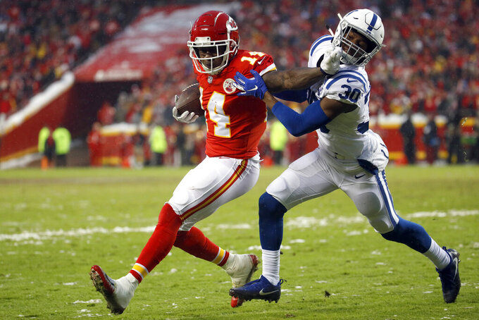 Kansas City Chiefs wide receiver Sammy Watkins (14) is tackled by Indianapolis Colts defensive back George Odum (30) during the first half of an NFL divisional football playoff game in Kansas City, Mo., Saturday, Jan. 12, 2019. (AP Photo/Charlie Riedel)