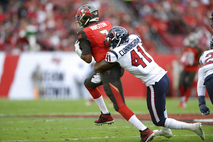 FILE - Houston Texans inside linebacker Zach Cunningham (41) sacks Tampa Bay Buccaneers quarterback Jameis Winston (3) during the second half of an NFL football game Saturday, Dec. 21, 2019, in Tampa, Fla. The Houston Texans have signed inside linebacker Zach Cunningham to a four-year, $58 million contract extension. The Texans announced the signing on Monday, Aug. 31, 2020. (AP Photo/Jason Behnken, File)