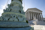The Supreme Court is seen in Washington, Monday, June 17, 2019. The Supreme Court is throwing out an Oregon court ruling against bakers who refused to make a wedding cake for a same-sex couple. The move keeps the high-profile case off the court's election-year calendar and orders state judges to take a new look at the dispute between the lesbian couple and the owners of a now-closed bakery. The justices already have agreed to decide whether federal civil rights law protects people from job discrimination due to their sexual orientation or gender identity. (AP Photo/J. Scott Applewhite)