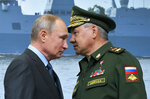 FILE In this file photo taken on Tuesday, April 23, 2019, Russian President Vladimir Putin, left, and Russian Defense Minister Sergei Shoigu during a visit a shipyard in St. Petersburg, Russia. Russian President Vladimir Putin prepares to mark his 20th year in power, as the longest-serving leader since Joseph Stalin.  (Alexei Druzhinin, Sputnik, Kremlin Pool Photo via AP, File)
