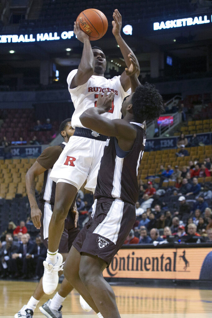 Rutgers' Montez Mathis shoots on St. Bonaventure's Alejandro Vasquez during the first half of an NCAA college basketball game in the James Naismith Classic, in Toronto on Saturday, Nov. 16, 2019. (Chris Young/The Canadian Press via AP)