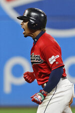 Cleveland Indians' Francisco Lindor reacts after hitting a two-run double during the seventh inning of the team's baseball game against the Boston Red Sox, Tuesday, Aug. 13, 2019, in Cleveland. (AP Photo/Tony Dejak)