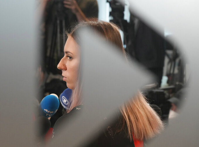 Belarusian Olympic sprinter Krystsina Tsimanouskaya, who came to Poland, fearing reprisals at home after criticizing her coaches at the Tokyo Games, talks to reporters in Warsaw, Poland, Thursday, Aug. 5, 2021. (AP Photo/Czarek Sokolowski)