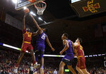 Iowa State forward Solomon Young, left, finds a shot past TCU center Kevin Samuel, center, during the second half of an NCAA college basketball game, Tuesday, Feb. 25, 2020, in Ames, Iowa. Iowa State won 65-59. (AP Photo/Matthew Putney)