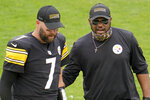 Pittsburgh Steelers quarterback Ben Roethlisberger (7) walks off the field with head coach Mike Tomlin after an NFL football game against the Houston Texans, Sunday, Sept. 27, 2020, in Pittsburgh. (AP Photo/Gene J. Puskar)