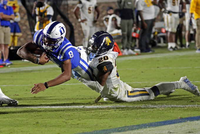Duke quarterback Jordan Moore (8) runs for a touchdown against North Carolina A&T defensive back Najee Reams (20) during the second half of an NCAA college football game in Durham, N.C., Friday, Sept. 10, 2021. (AP Photo/Chris Seward)