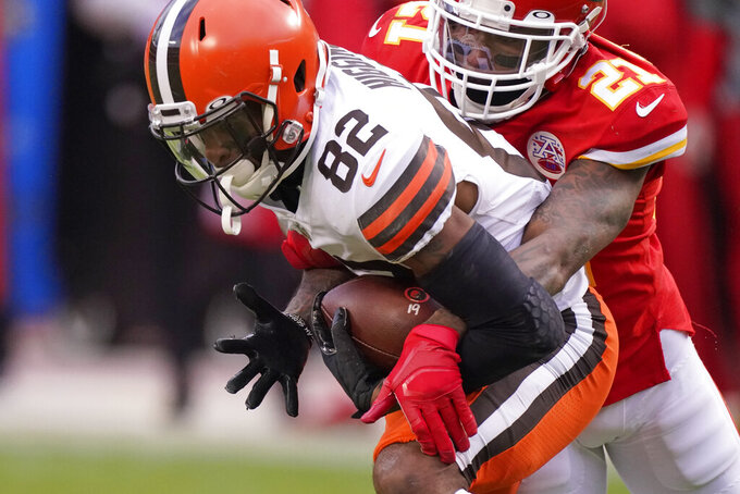 Cleveland Browns wide receiver Rashard Higgins (82) is tackled by Kansas City Chiefs cornerback Bashaud Breeland (21) after catching a pass during the second half of an NFL divisional round football game, Sunday, Jan. 17, 2021, in Kansas City. (AP Photo/Charlie Riedel)