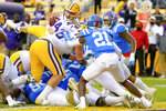 LSU quarterback Max Johnson (14) jumps in an attempt to score against Mississippi in the first half of an NCAA college football game in Baton Rouge, La., Saturday, Dec. 19, 2020. (AP Photo/Matthew Hinton)