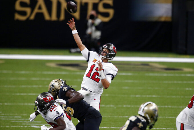 Tampa Bay Buccaneers quarterback Tom Brady (12) passes in the second half of an NFL football game against the New Orleans Saints in New Orleans, Sunday, Sept. 13, 2020. (AP Photo/Butch Dill)