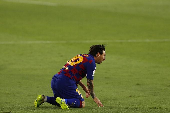 Barcelona's Lionel Messi reacts during the Spanish La Liga soccer match between Sevilla and FC Barcelona at the Ramon Sanchez-Pizjuan stadium in Seville, Spain, Friday, June 19, 2020. (AP Photo/Angel Fernandez)