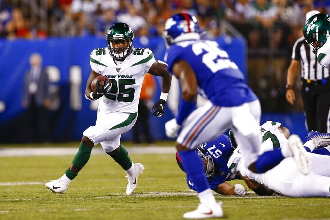 New York Jets running back Elijah McGuire (25) rushes during the first half of the team's preseason NFL football game against the New York Giants Thursday, Aug. 8, 2019, in East Rutherford, N.J. (AP Photo/Adam Hunger)
