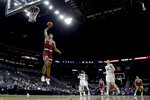 Stanford center Keenan Fitzmorris (12) dunks the ball during the second half of an NCAA college basketball game against Oklahoma Monday, Nov. 25, 2019, in Kansas City, Mo. Stanford won 73-54. (AP Photo/Charlie Riedel)
