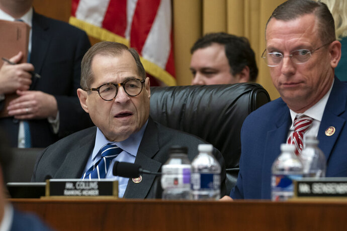 House Judiciary Committee Chairman Jerrold Nadler, D-N.Y., and Rep. Doug Collins, R-Georgia, right, the ranking member, listen to debate on amendments as the panel approved procedures for upcoming impeachment investigation hearings on President Donald Trump, on Capitol Hill in Washington, Thursday, Sept. 12, 2019. (AP Photo/J. Scott Applewhite)