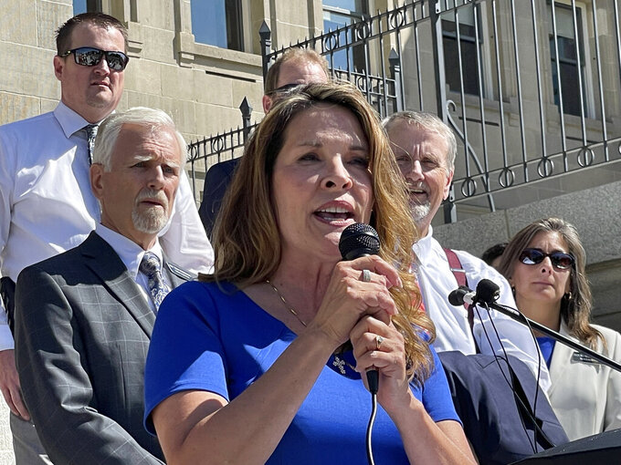 Republican Lt. Gov. Janice McGeachin addresses a rally on the Statehouse steps on Wednesday, Sept. 15, 2021, in Boise, Idaho. Far-right Republican lawmakers in the House tried but failed to draw enough lawmakers for a quorum to reconvene the House. (AP Photo/Keith Ridler)