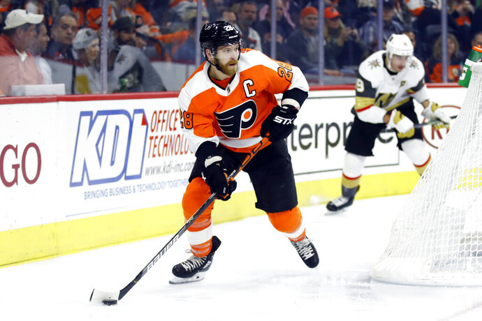 FILE - In this Oct. 21, 2019, file photo, Philadelphia Flyers' Claude Giroux controls the puck during an NHL hockey game against the Vegas Golden Knights in Philadelphia. Among the unknowns about the NHL returning amid the coronavirus pandemic is what the on-ice product might look like. (AP Photo/Matt Rourke, File)
