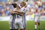 Lyon's Delphine Cascarino, center, celebrates with Ada Hegerberg, right, and Lucy Bronze, left, after scoring a goal against Chelsea during their Women's Champions League semifinal soccer match in Decines, France, Sunday, April 21, 2019. (AP Photo/Laurent Cipriani)
