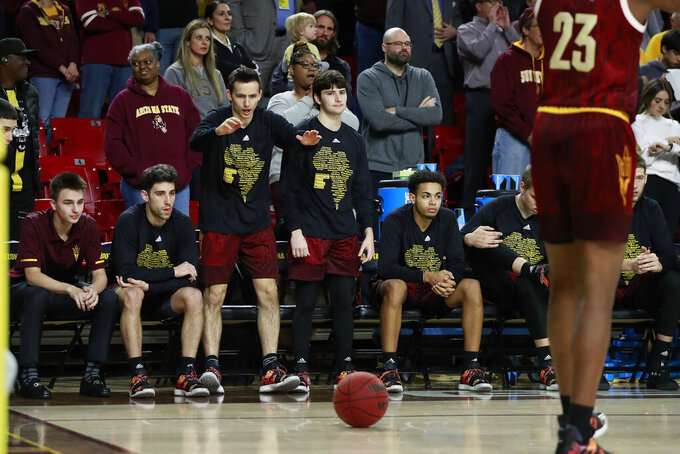Arizona State players watch from the bench during the first half of the team's NCAA college basketball game against Washington State, Thursday, Feb. 7, 2019, in Tempe, Ariz. The players at the end of the bench watch the score running up and the clock winding down, wondering when it will be their turn to finally get a chance to play. Most of the time, it doesn't happen until the final minute--even when a game has long been out of reach. (AP Photo/Matt York)