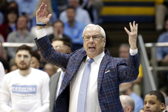 North Carolina head coach Roy Williams protests a call during the first half of an NCAA college basketball game against Virginia at the Dean Smith Center in Chapel Hill, N.C., Saturday, Feb. 15, 2020. (AP Photo/Chris Seward)