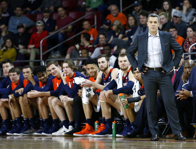 FILE - In this Wednesday, Jan. 9, 2019, file photo, Virginia head coach Tony Bennett stands at the bench during the first half of an NCAA basketball game against Boston College, in Boston. The fourth-ranked Cavaliers face No. 9 Virginia Tech and No. 1 Duke the week of Jan. 14. (AP Photo/Mary Schwalm, File)