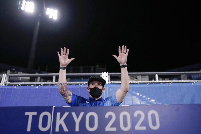 Emcee Michael Rivas poses for a picture during a men's beach volleyball quarterfinal match at the 2020 Summer Olympics, Wednesday, Aug. 4, 2021, in Tokyo, Japan. Everyone at the Olympics has had to adjust to the absence of crowds that have stripped the Tokyo Games of their usual flag-waving, anthem-singing spirit. But perhaps no one has faced a bigger challenge than the courtside entertainment at Shiokaze Park. (AP Photo/Petros Giannakouris)
