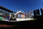 A 15-story high ski slope is shown during practice for the Big Air Atlanta snowboard and ski competition at SunTrust Park Thursday, Dec. 19, 2019, in Atlanta. (AP Photo/John Bazemore)