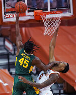 Baylor guard Davion Mitchell (45) scores over Texas forward Royce Hamm Jr. (5) during the first half of an NCAA college basketball game Tuesday, Feb. 2, 2021, in Austin, Texas. (AP Photo/Eric Gay)