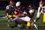 Southern California linebacker Drake Jackson (99) tackles Arizona running back Gary Brightwell (0) in the second half during an NCAA college football game, Saturday, Nov. 14, 2020, in Tucson, Ariz. (AP Photo/Rick Scuteri)