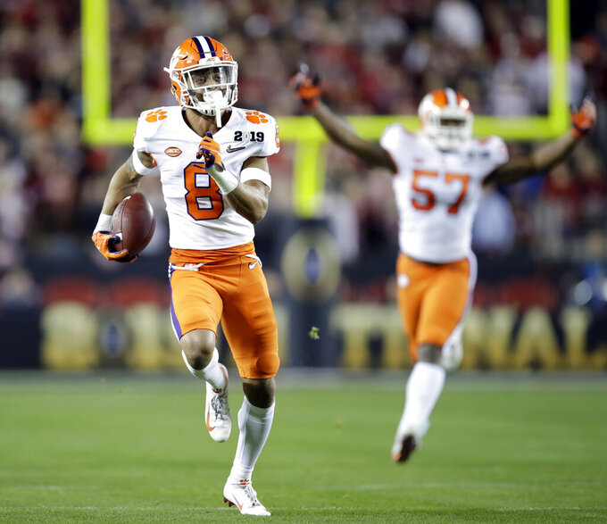 FILE - In this Jan. 7, 2019, file photo, Clemson's A.J. Terrell intercepts a pass for a touchdown during the first half the NCAA college football playoff championship game against Alabama in Santa Clara, Calif. Terrell was chosen by the Atlanta Falcons in the first round of the NFL draft. (AP Photo/Ben Margot, File)