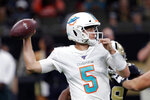 Miami Dolphins quarterback Jake Rudock (5) passes in the first half of an NFL preseason football game against the New Orleans Saints in New Orleans, Thursday, Aug. 29, 2019. (AP Photo/Bill Feig)