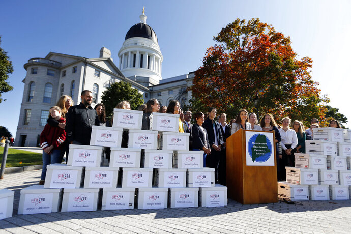 Cara Sacks, co-chair of Mainers for Health and Parental Rights, speaks at a news conference before her group delivered petitions to the Secretary of State's office, Wednesday, Sept. 18, 2019, in Augusta, Maine. The group says they gathered over 92,000 signatures in support of the People's Veto of government-mandated vaccine bill. (AP Photo/Robert F. Bukaty)